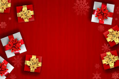 Red christmas background - gifts and snowflakes Stock Images