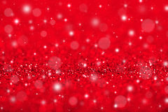 Red Christmas background. Christmas background with red glitters, sparkles and bokeh Stock Images