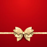 Red Christmas background with gold bow. Red Christmas background with gold shining bow Royalty Free Stock Images