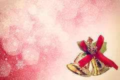 Red christmas background with golden bels Royalty Free Stock Photo