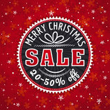Red christmas background and  label with sale offer Royalty Free Stock Photos