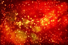 Red Christmas background with lights, stars, glitter. Royalty Free Stock Photography