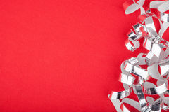 Red Christmas background. Red new year background with silver strands and space for text Stock Photography