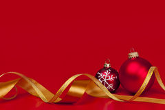 Red Christmas background with ornaments. And gold ribbon Royalty Free Stock Images