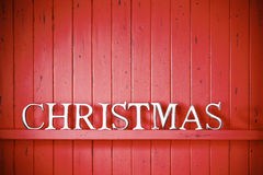 Red Christmas Background. A red painted wood background with the word Christmas on it.* Please see this this image No: 92559331 as a variation Royalty Free Stock Photos