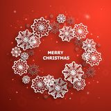 Red Christmas background with paper snowflakes. And text Stock Photos