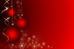 Red Christmas background with place for your text. Bright Christmas balls on red background with space for text Royalty Free Stock Images