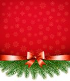 Red christmas background with ribbon and branches. Stock Photography