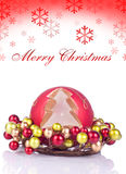 Red christmas background with snowflakes. Red candle in xmas candle holder with text behind Royalty Free Stock Images