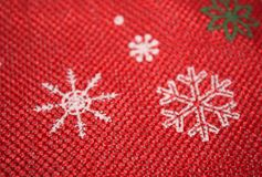 Red Christmas background with snowflakes. Flat lay New year minimal pattern royalty free stock image