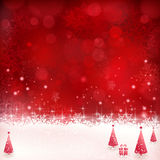 Red Christmas background with snowflakes, stars and Christmas tr Royalty Free Stock Image