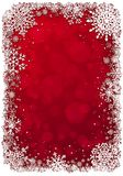 Red Christmas background with snowflakes. Royalty Free Stock Images