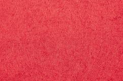 Red Christmas background texture of felt fabric wallpaper royalty free stock photos