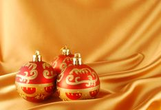 Red christmas bal. Three red christmas ball on the gold background royalty free stock image