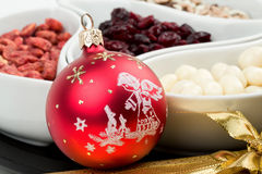 Red christmas bal with chocolate nuts Royalty Free Stock Images