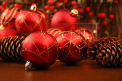 Red Christmas ball. With pine cones Stock Photos