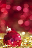 Red christmas ball. On abstract golden background royalty free stock photos