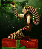 The red Christmas Ball. A cute Christmas Elf with pointed cap Royalty Free Stock Photos