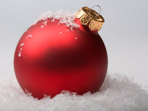 Red christmas ball. On snow Royalty Free Stock Image