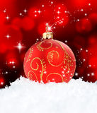 Red Christmas Ball on black royalty free stock photos