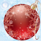 Red christmas ball on a blue background Royalty Free Stock Photography