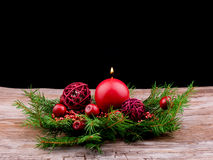 Red christmas ball and candle Stock Image