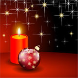 Red christmas ball and candle Royalty Free Stock Images