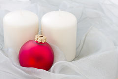 Red christmas ball with candles Stock Image