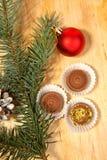 Red christmas ball and chocolate Royalty Free Stock Photos