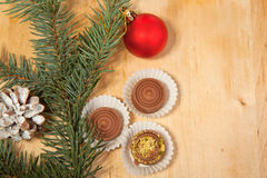 Red christmas ball and chokolate Royalty Free Stock Image