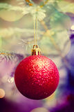 Red Christmas ball on Christmas tree Stock Images