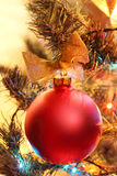 Red Christmas ball on a Christmas tree Royalty Free Stock Images