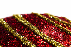 Red christmas ball close up. Red christmas ball with yellow stripes close up Stock Images