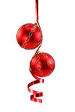 Red Christmas ball with a curly ribbon Royalty Free Stock Photography