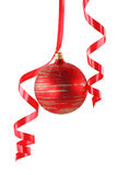 Red Christmas ball with a curly ribbon Stock Images