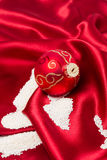 Red christmas ball decoration with sugar as snow. Royalty Free Stock Photo