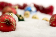Red christmas ball with decoration on white snow Stock Photo