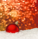 Red christmas ball on the defocused background Royalty Free Stock Image