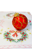 Red Christmas ball embroidered napkin isolated Stock Photo