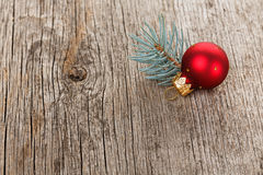 Red Christmas ball with fir branch Royalty Free Stock Images