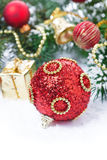 Red Christmas ball with fir branches and decorations Stock Image