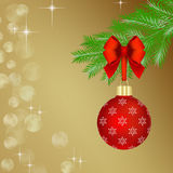 Red Christmas ball on fir tree branch Royalty Free Stock Photography