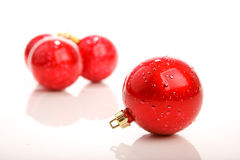 Red christmas ball in front of three baubles Royalty Free Stock Photography