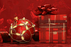 Red Christmas ball and gift box Stock Images