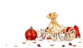 Red christmas ball and golden bag with gifts isolated Royalty Free Stock Photography