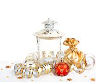 Red christmas ball, golden bag with gifts and old vintage lamp Royalty Free Stock Image
