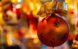 Red christmas ball -golden bokeh background Stock Image