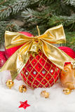 Red christmas ball with golden bow Royalty Free Stock Photos