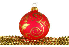 Red christmas ball and golden garland Royalty Free Stock Photos
