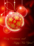 Red christmas ball with golden snowflake pattern Royalty Free Stock Photography